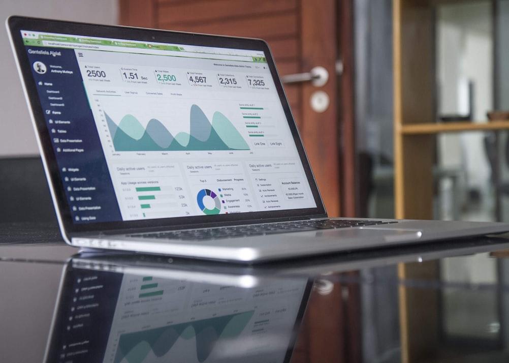 A laptop displaying various website metrics