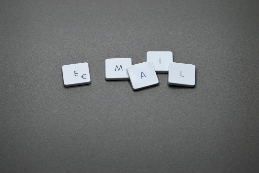 A grey background with email spelled out in laptop keys