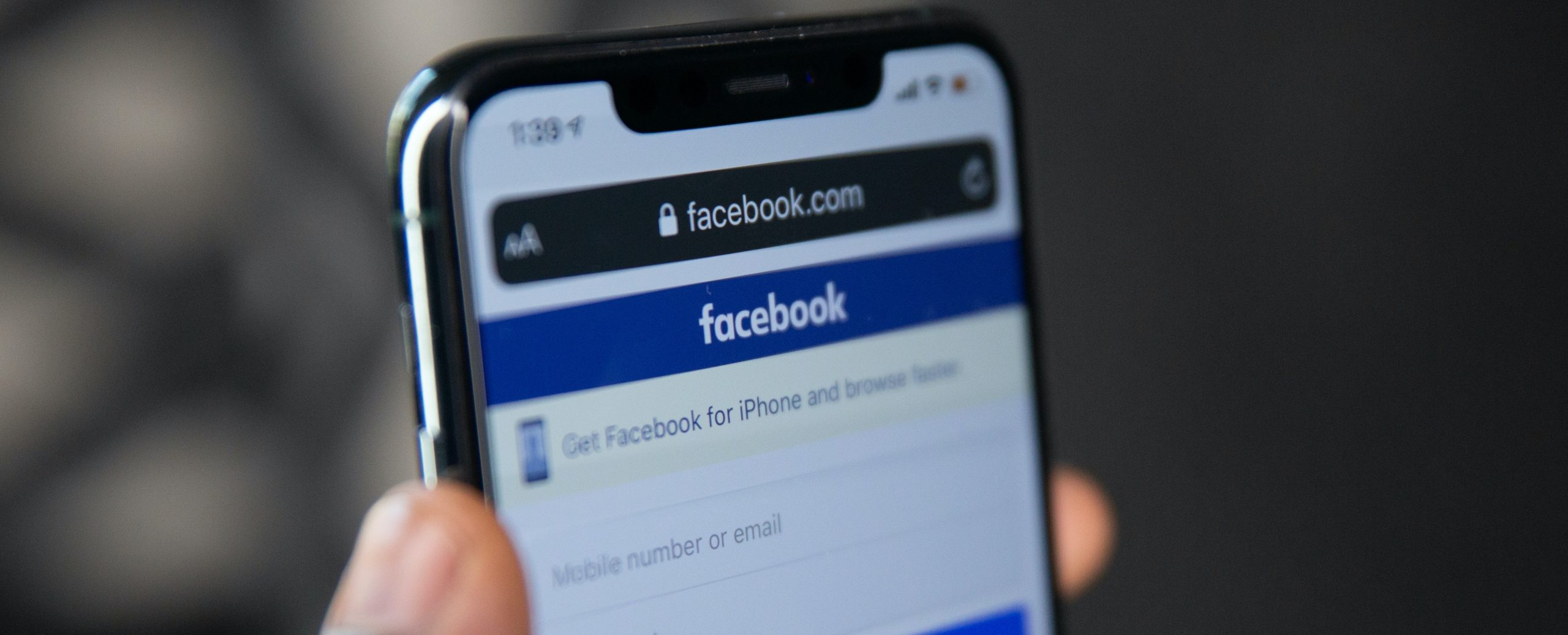 A phone with Facebook open in browser